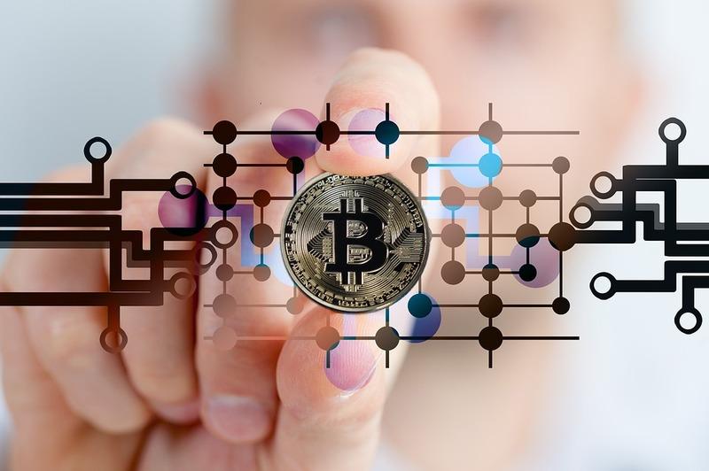 Crypto - Bitcoin Blockchain Background with Hand