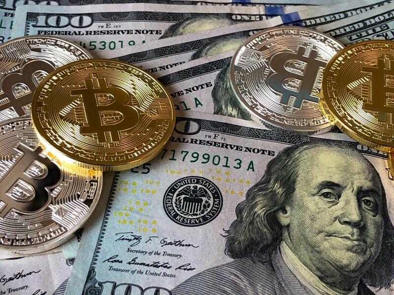 Crypto - Bitcoin and Hundred Dollar Bills