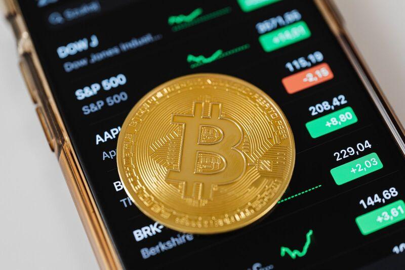 Crypto - Bitcoin on Phone Stock Prices Background
