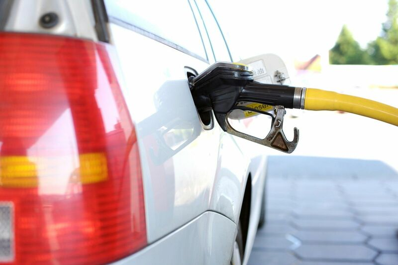 Energy - A car being refueled at a gas station