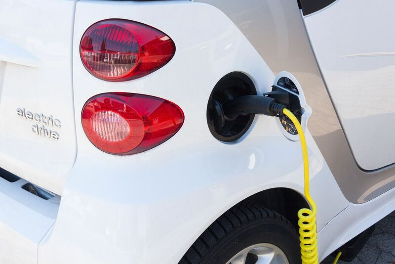 Energy - Electric car being recharged