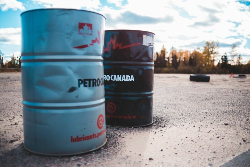 Energy - Two Oil Barrels on Ground
