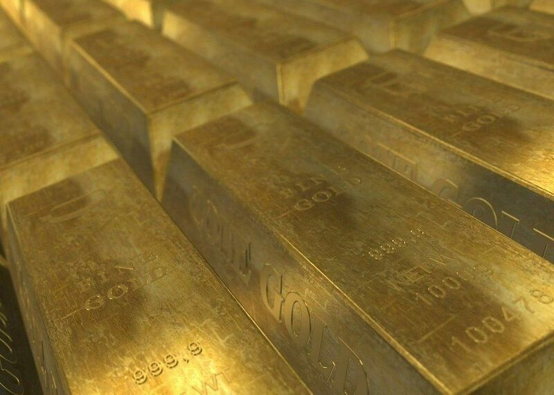 Metals - gold bars in a neat row