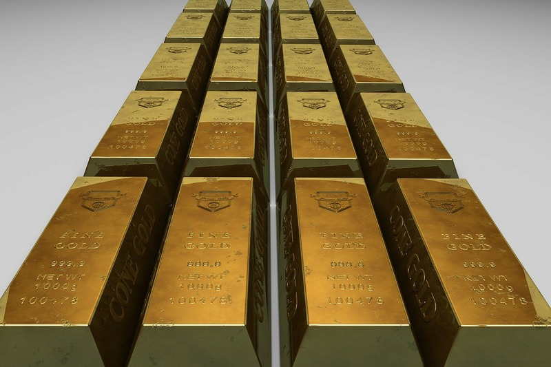 Metals - gold bars in a straight row