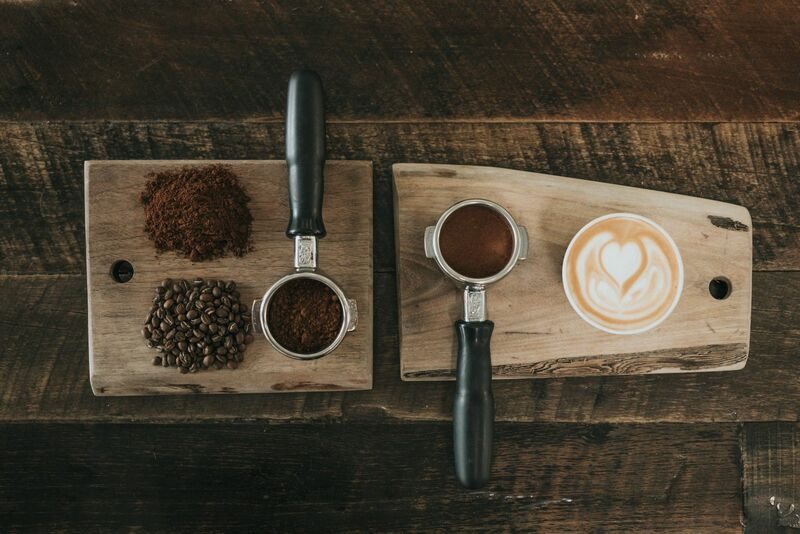 Softs - Beans and Filled Cups of Espresso on Wooden Board