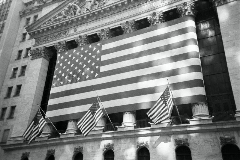 Stocks-Money-Rates - American flag on NY Stock Exchange -LwFSIbunVEE-unsplash