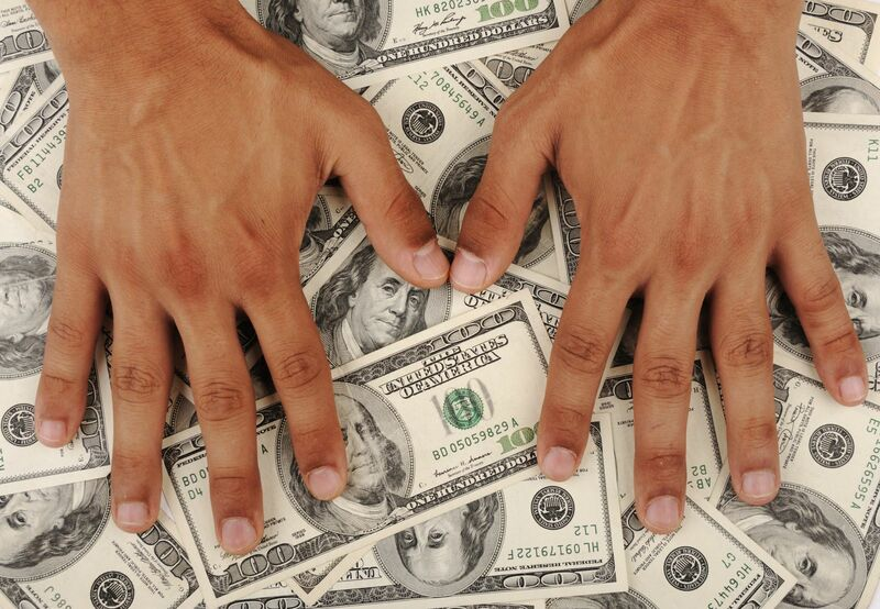 Stocks-Money-Rates - Pile of Money with Hands