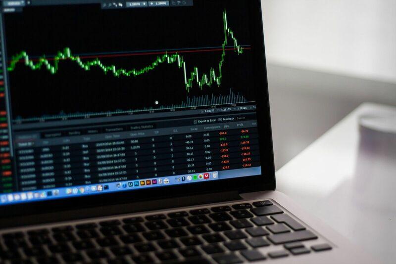Stocks-Money-Rates - Stock Market Ticker on Laptop